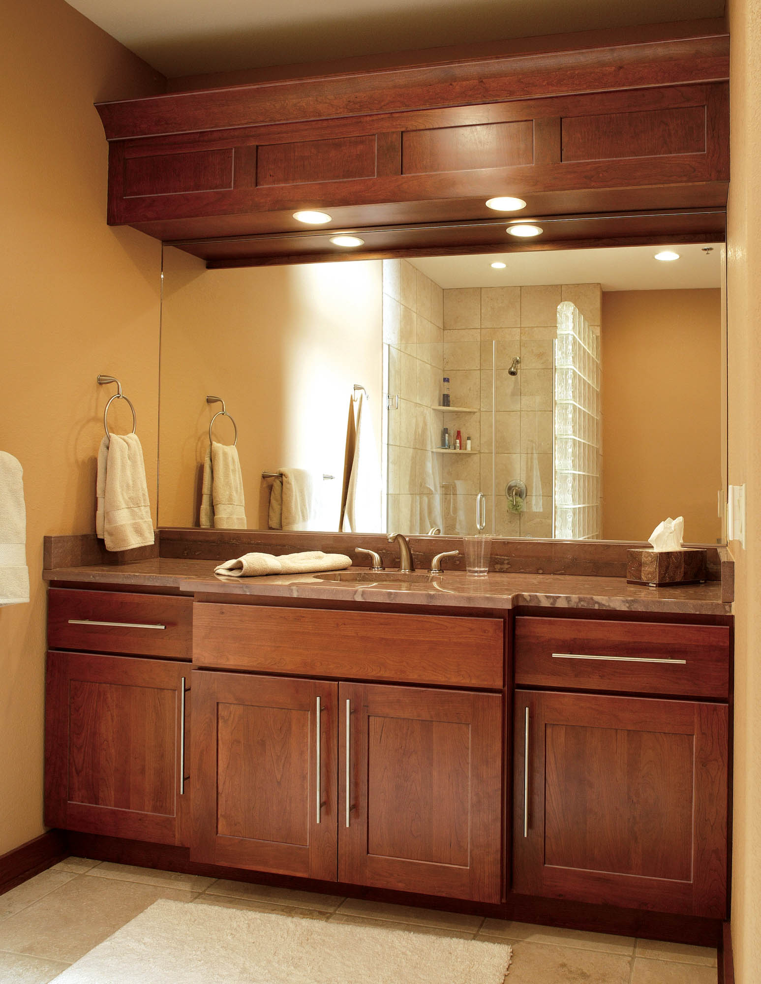 Stained bathroom cabinets in Cayenne by Showplace Cabinetry - view 1