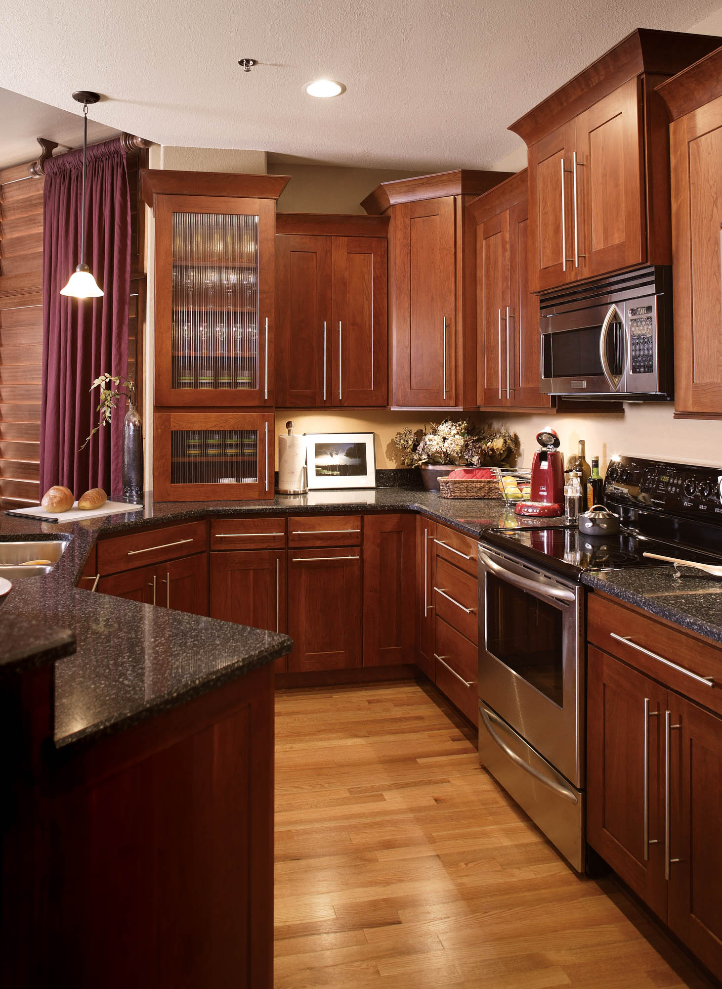 Stained kitchen cabinets in Cayenne by Showplace Cabinetry - view 2