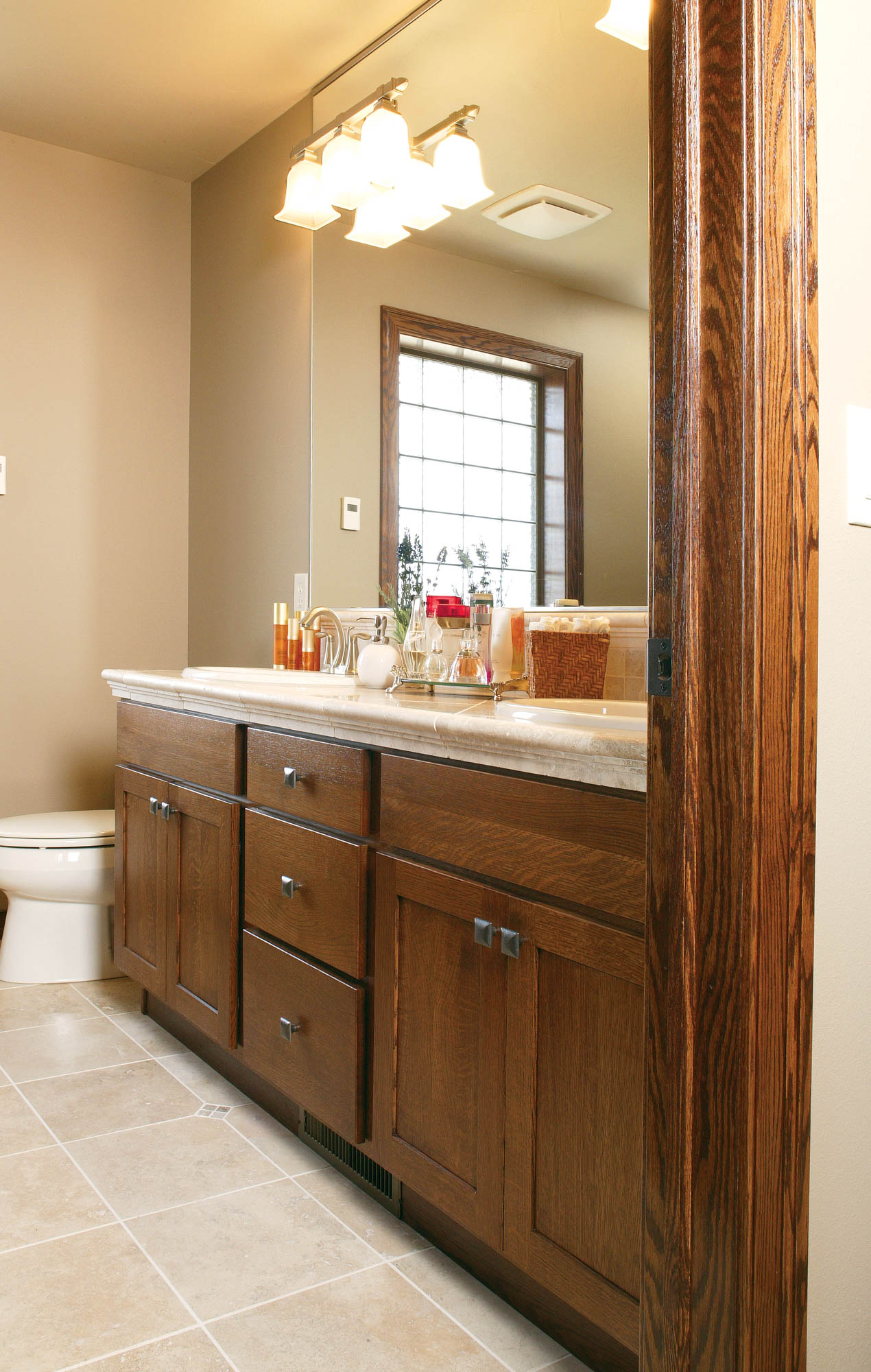 Stained bathroom vanity in Autumn with Ebony Glaze by Showplace Cabinetry - view 1