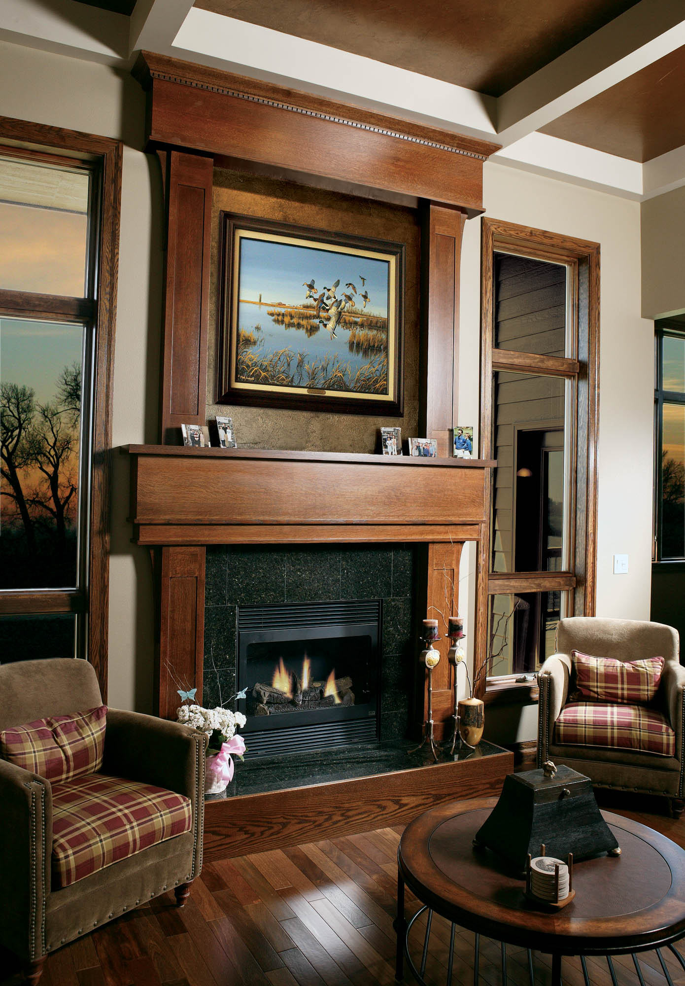 Stained family room fireplace surround in Autumn with Ebony Glaze by Showplace Cabinetry