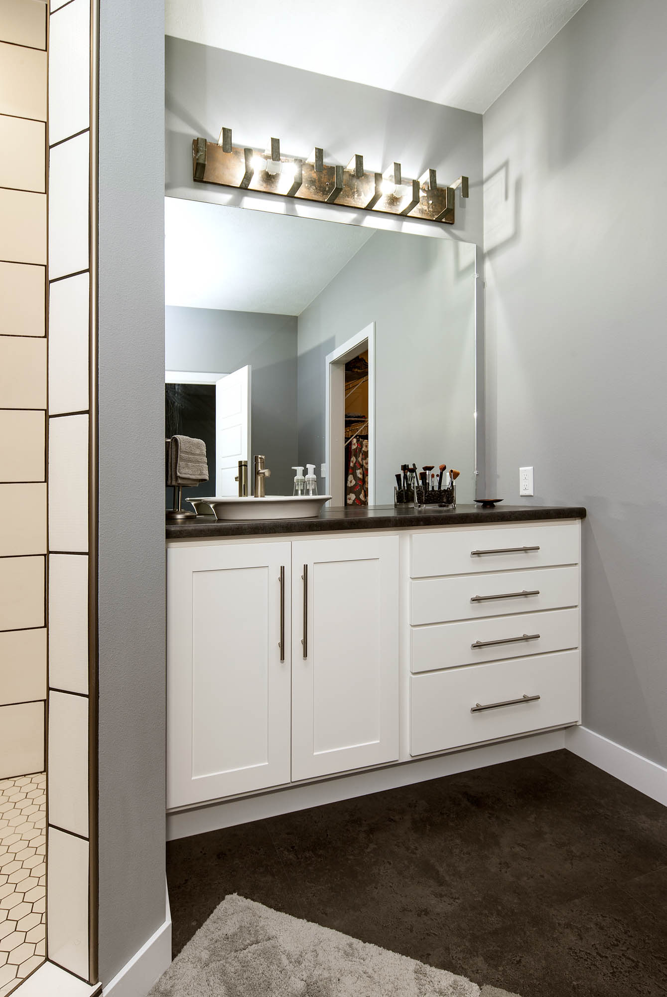 Painted guest bathroom vanity in White by Showplace Cabinetry