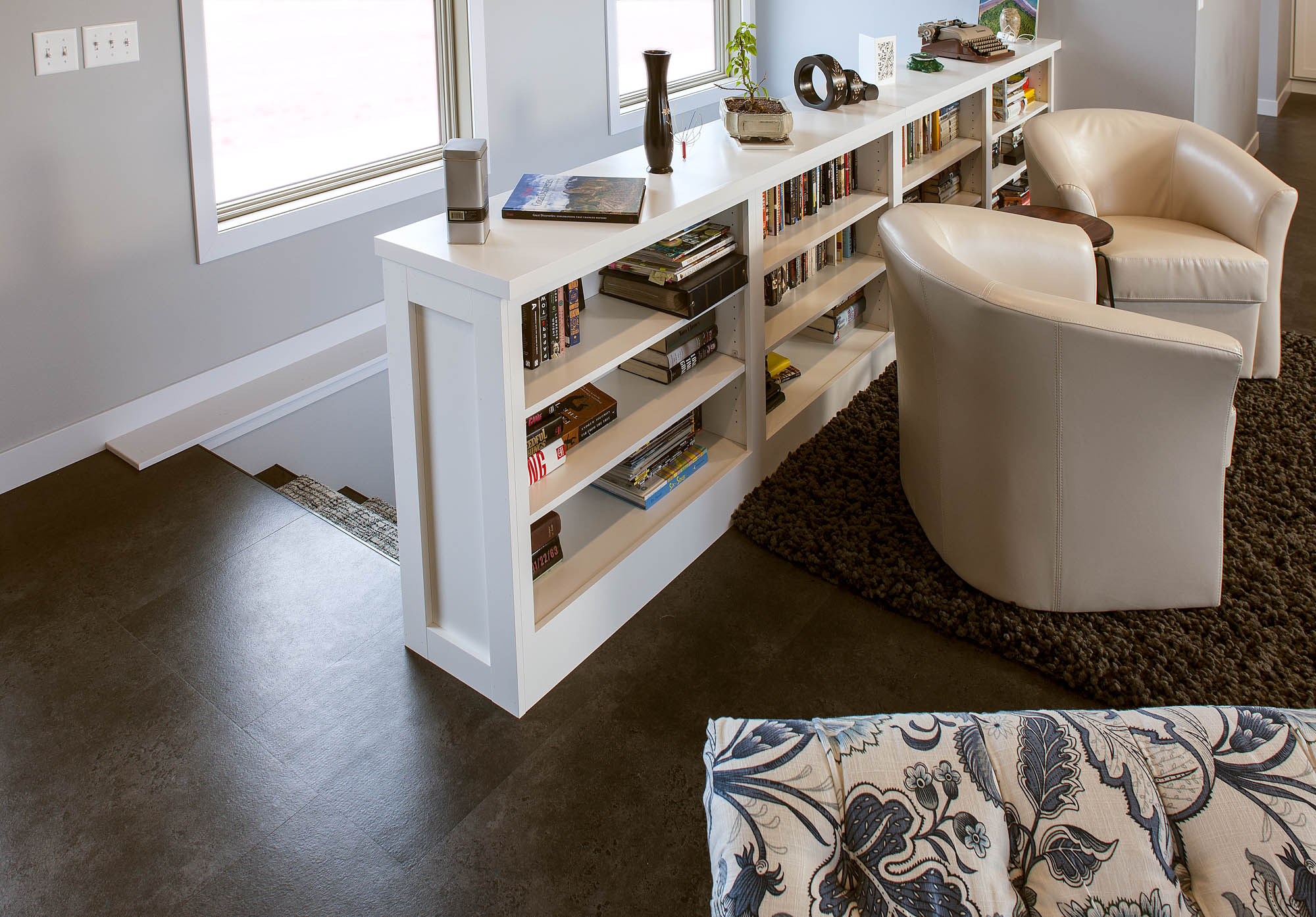 Painted family room bookcase in White by Showplace Cabinetry