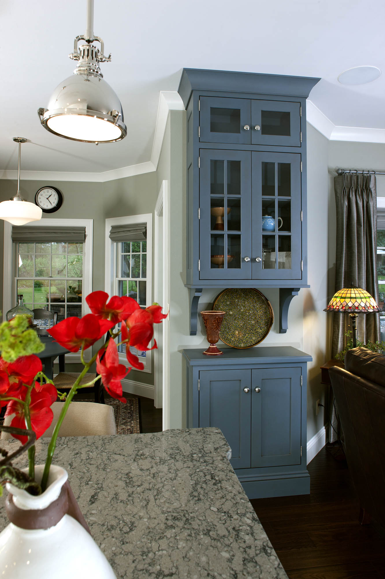Painted kitchen display hutch in Casual Vintage Smokey Blue by Showplace Cabinetry