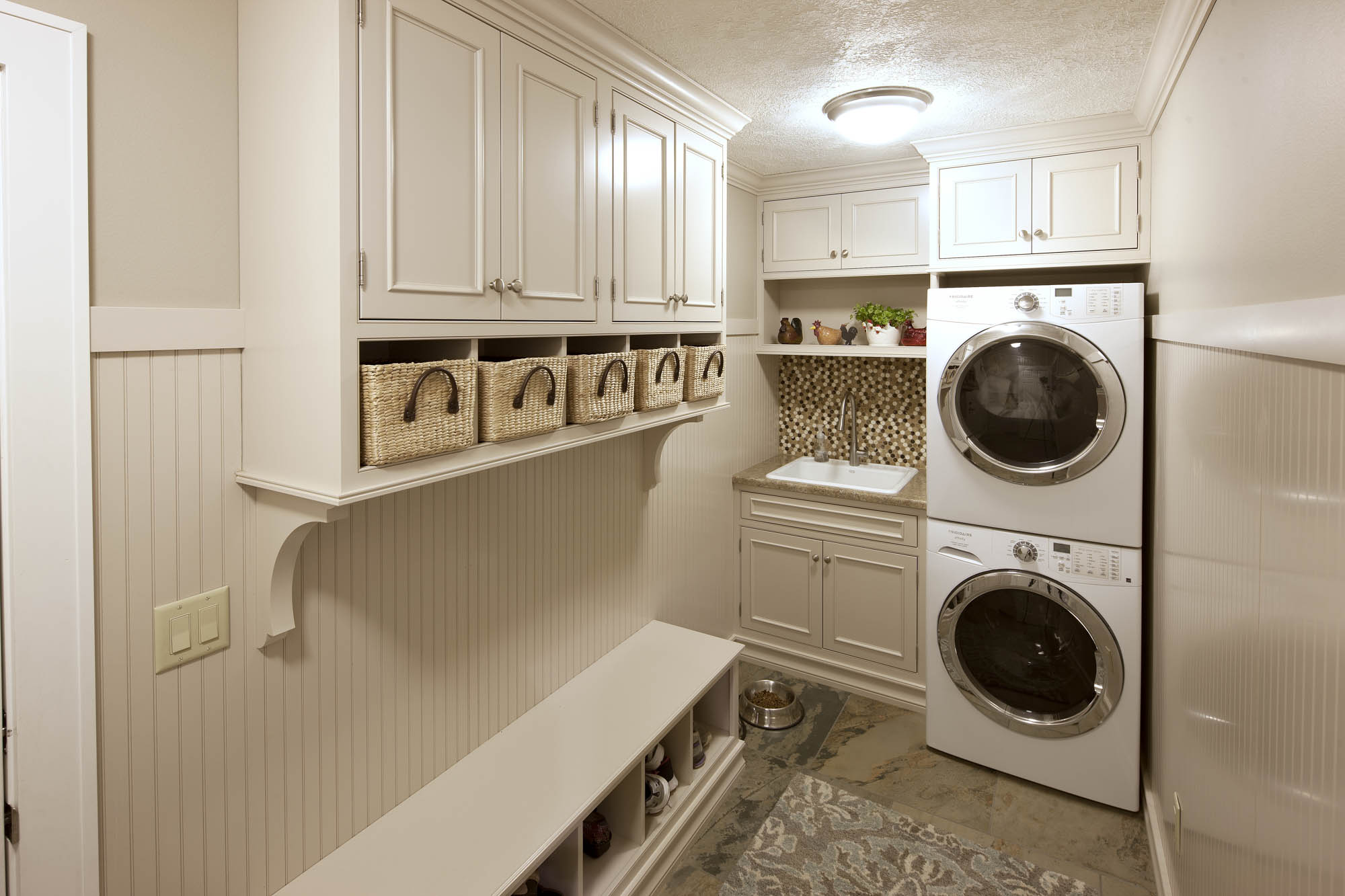 Painted laundry room cabinets in Light Mocha by Showplace Cabinetry