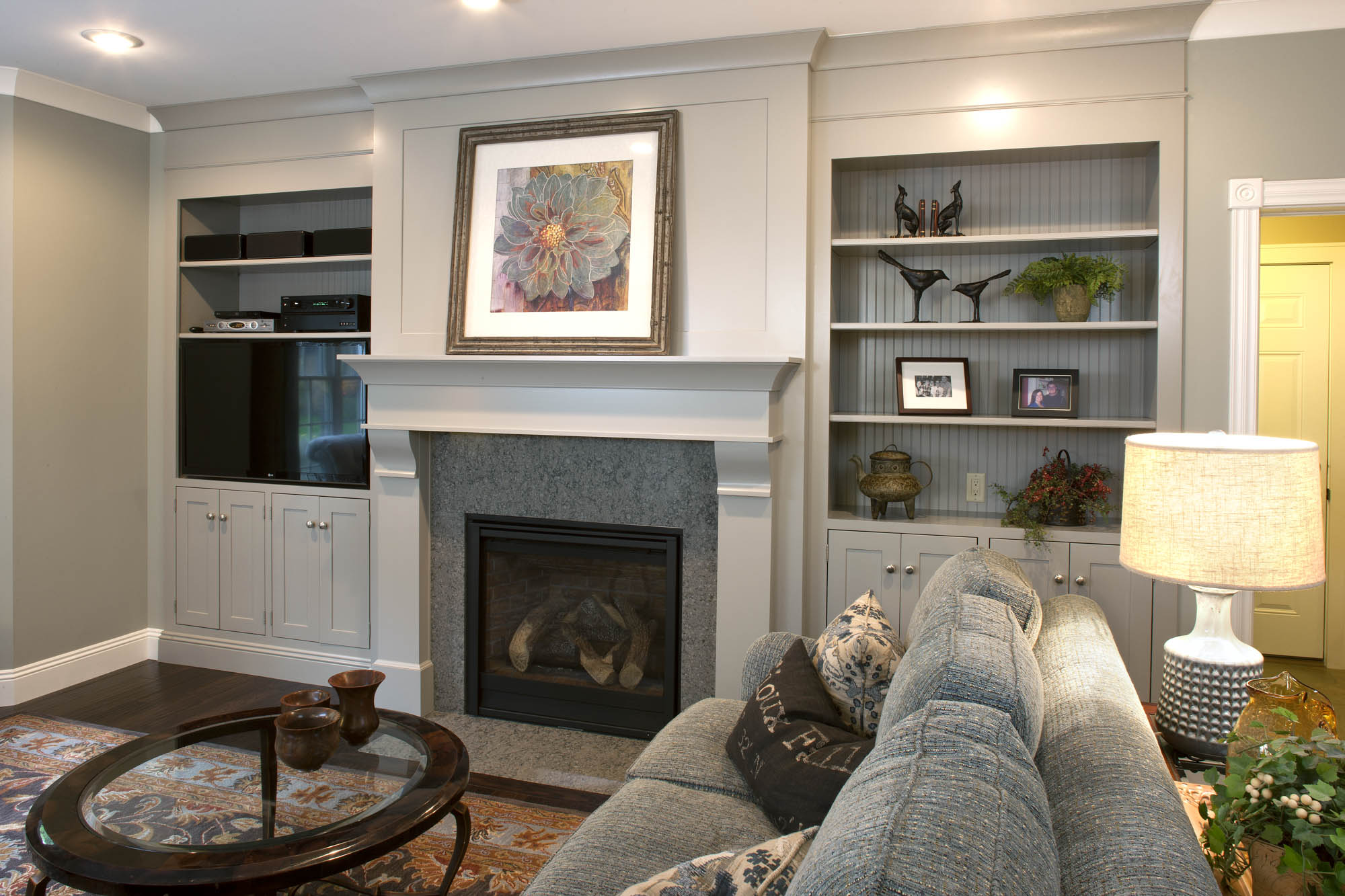 Painted family room fireplace surround in White by Showplace Cabinetry