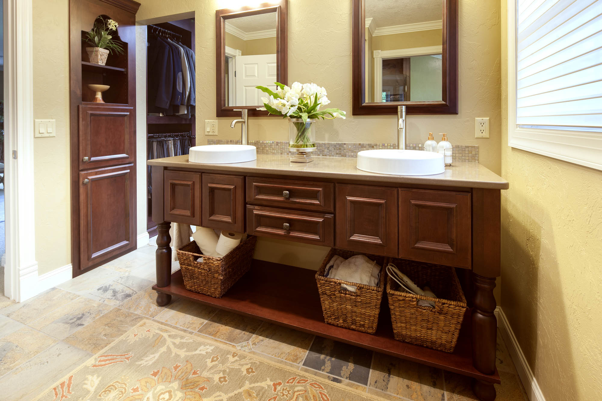 Stained master bathroom cabinets in Brandy by Showplace Cabinetry - view 1