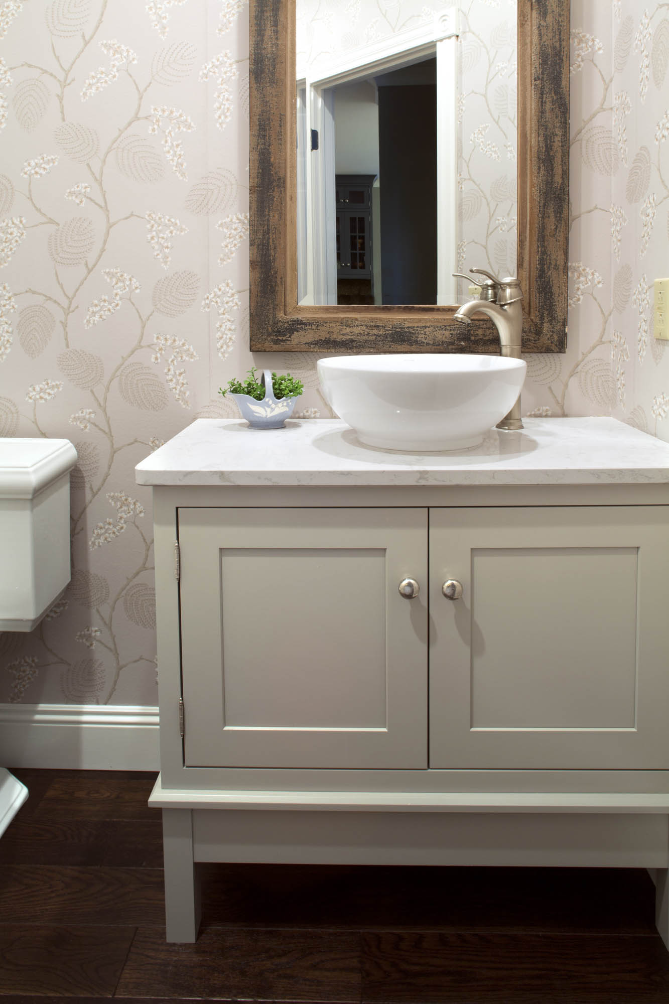 Painted powder room vanity in Dorian Gray by Showplace Cabinetry