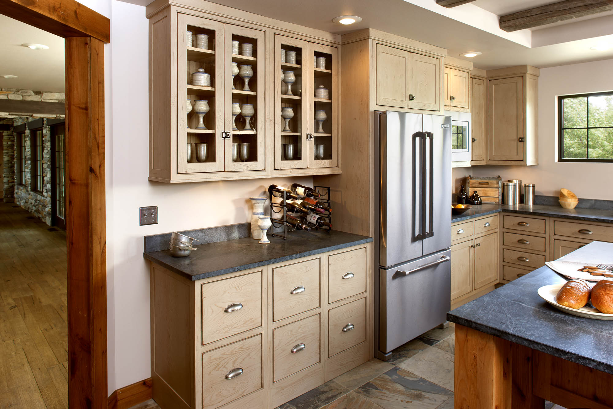 Painted kitchen cabinets in Sandstone by Showplace Cabinetry - view 2