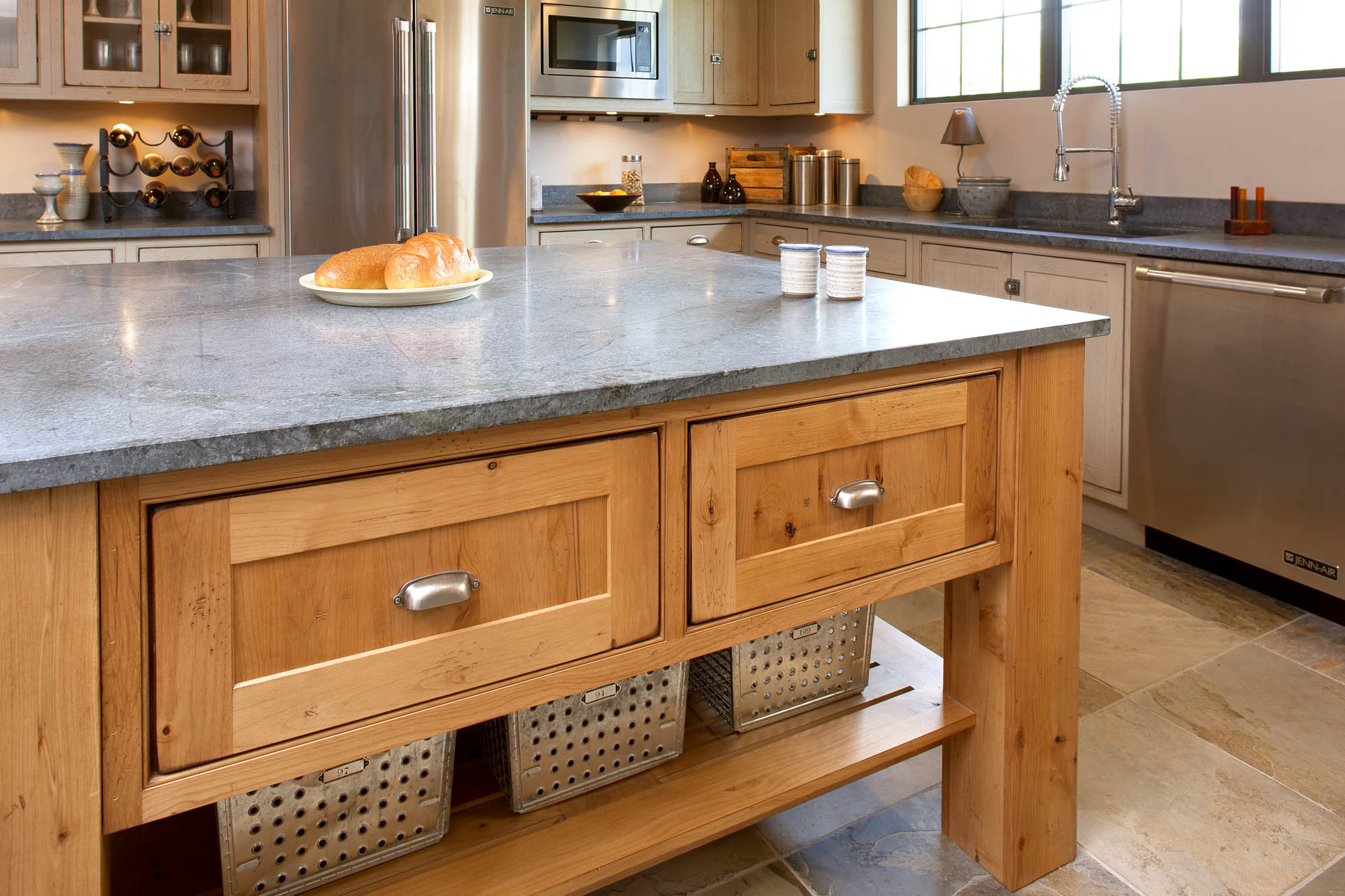 Stained kitchen island in Vintage Natural by Showplace Cabinetry
