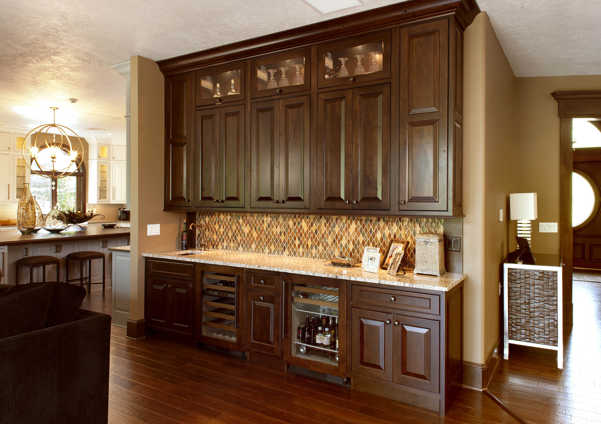 Stained family room wet bar in Distressed Coffee with Ebony Glaze by Showplace Cabinetry