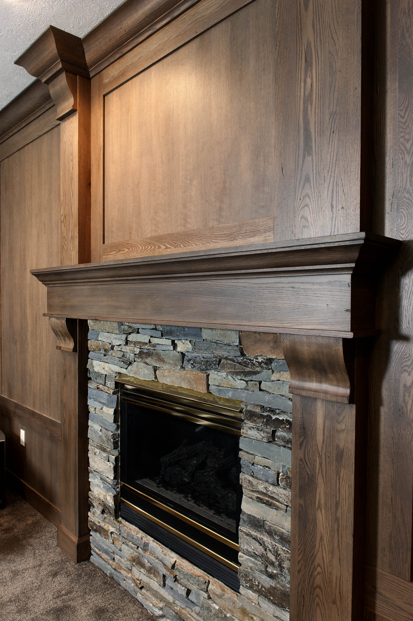 Stained family room 2 fireplace surround in Vintage Driftwood by Showplace Cabinetry