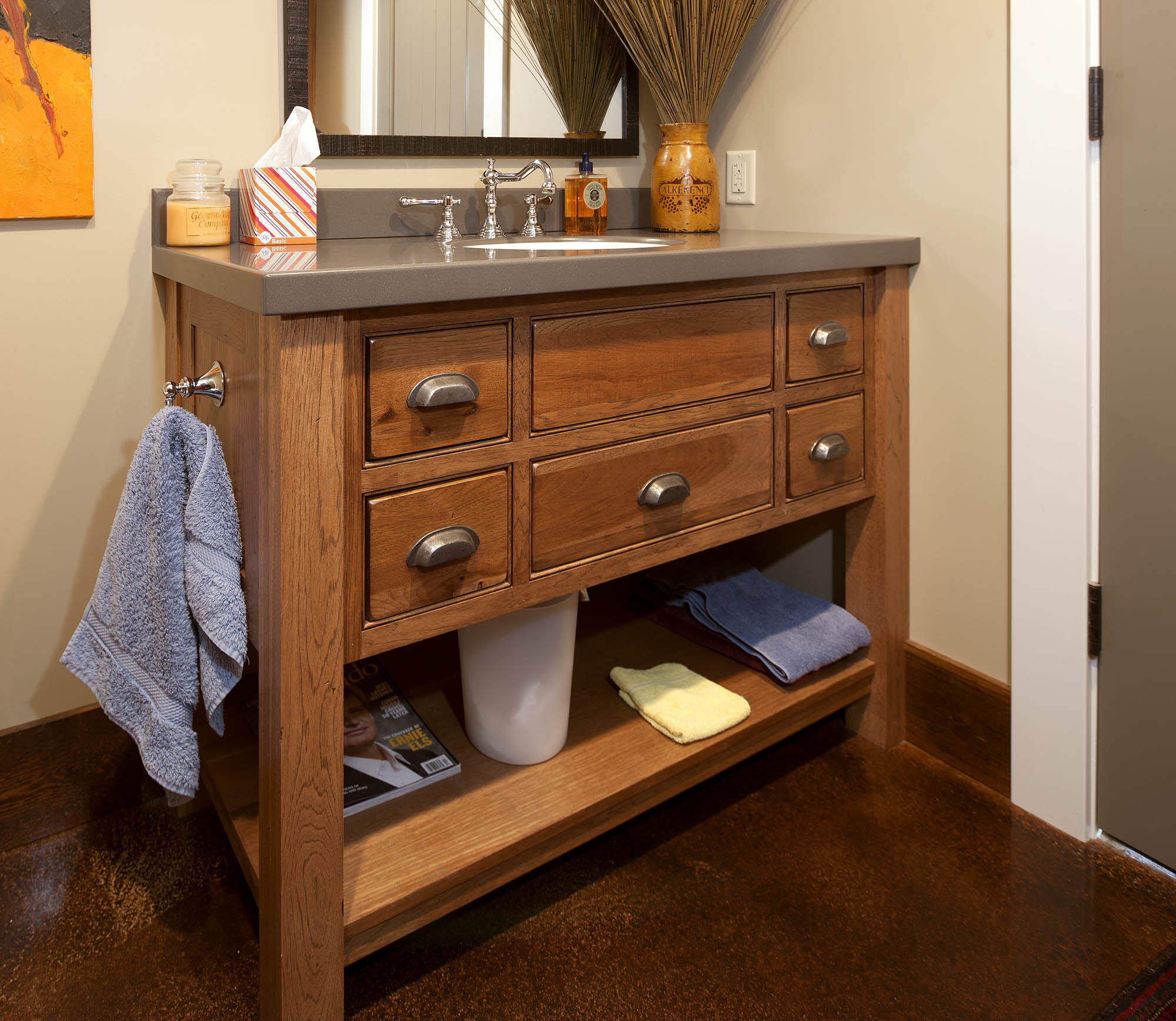 Stained guest bath 1 in Truffle with Ebony Glaze by Showplace Cabinetry