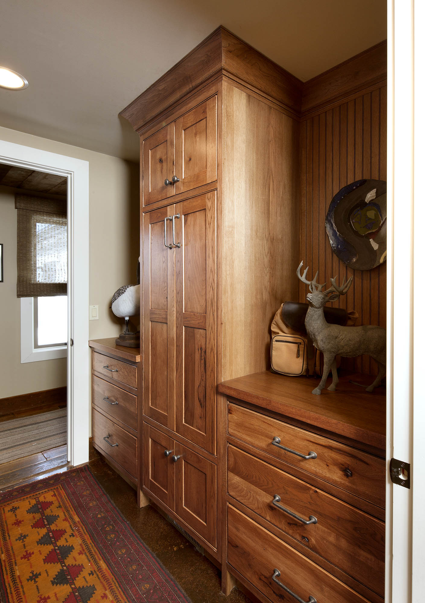 Stained guest bedroom cabinets in Truffle with Ebony Glaze by Showplace Cabinetry