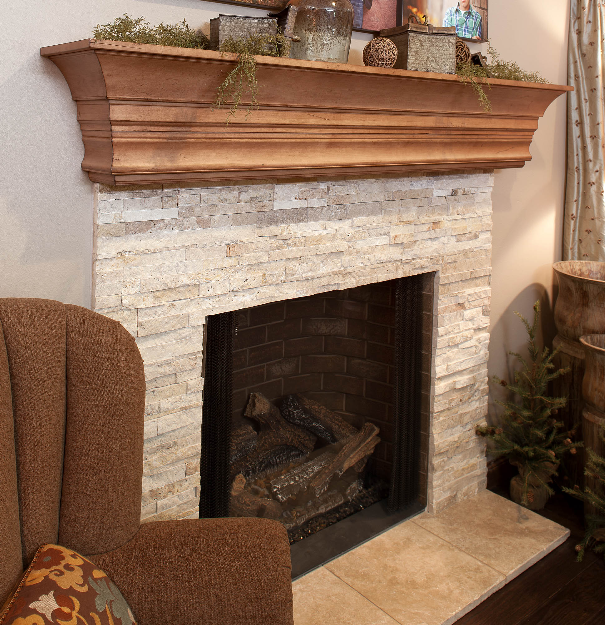 Stained family room mantle in Vintage Nutmeg by Showplace Cabinetry