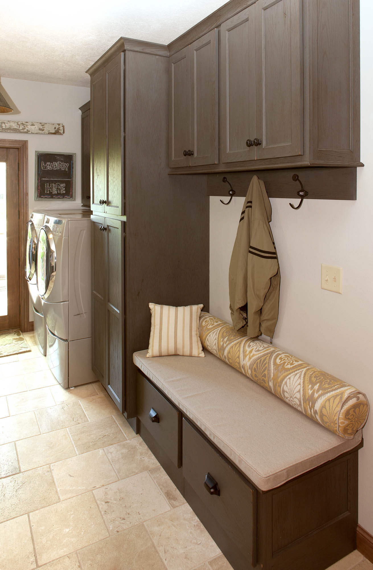 Painted laundry room locker in Vintage Graphite by Showplace Cabinetry
