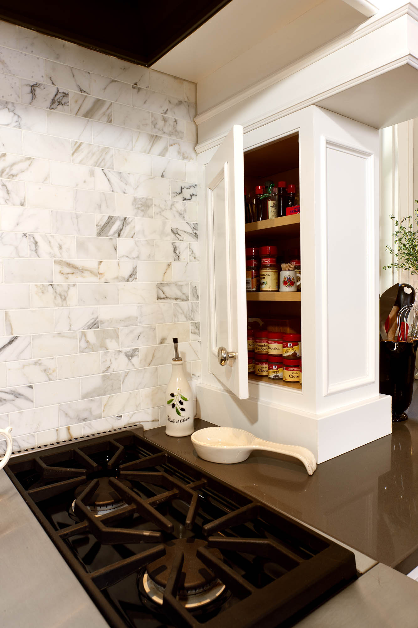 Painted kitchen cabinet with spice rack in White by Showplace Cabinetry