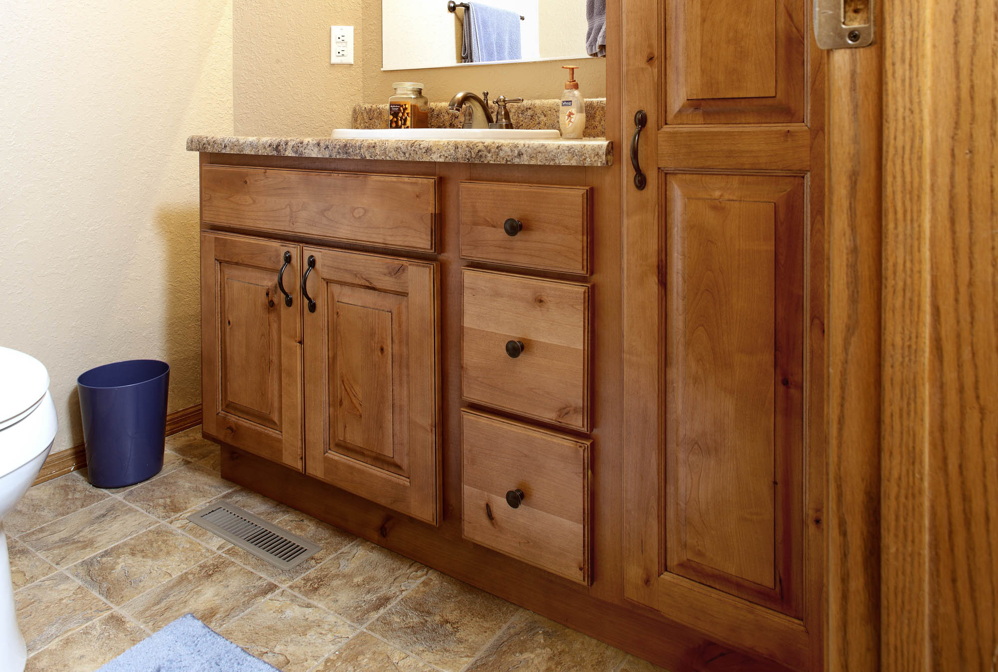 Renew   Stained bathroom vanity in Nutmeg with Ebony Glaze by Showplace Cabinetry
