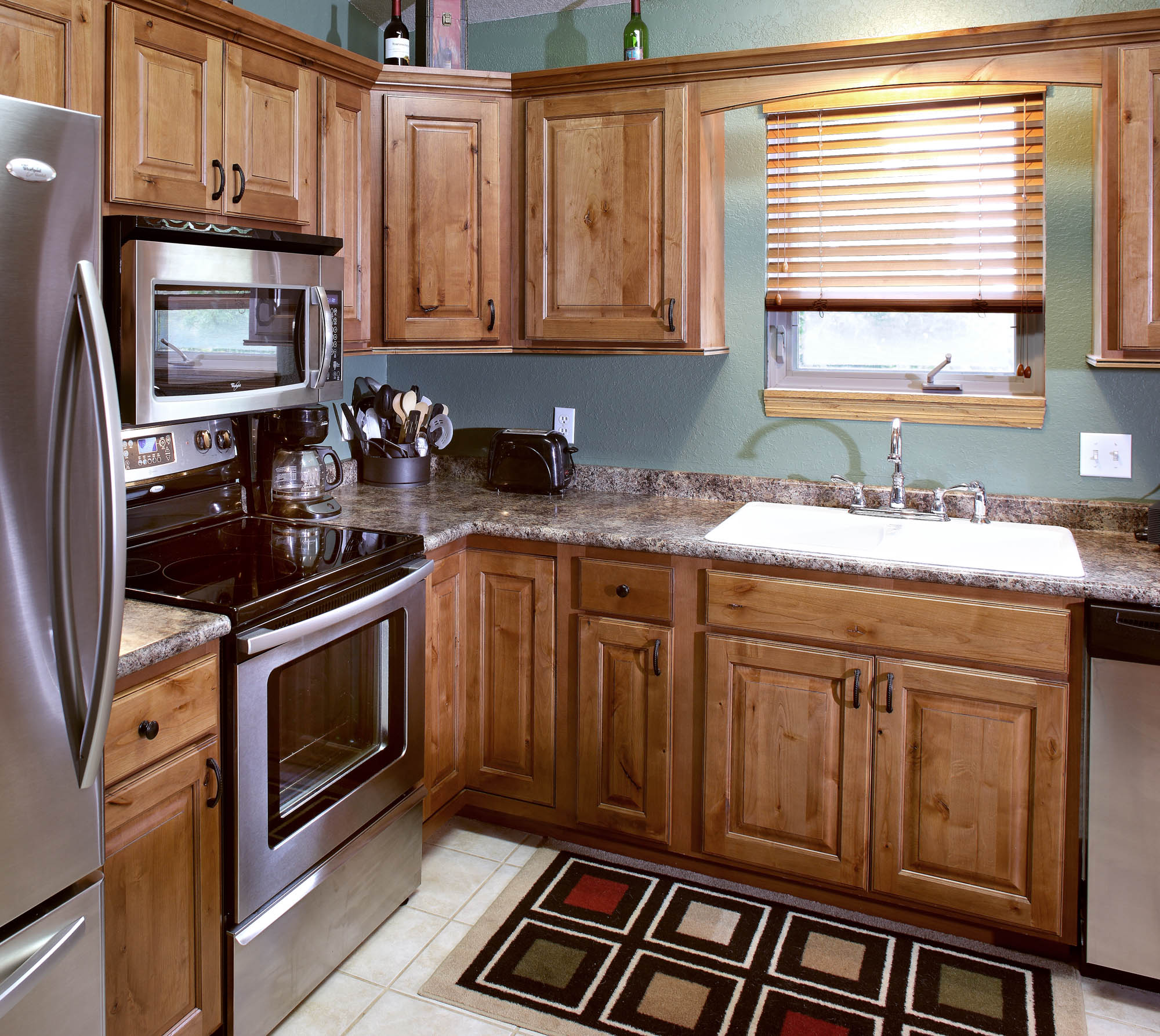 View The Warmth Of This Refaced Kitchen