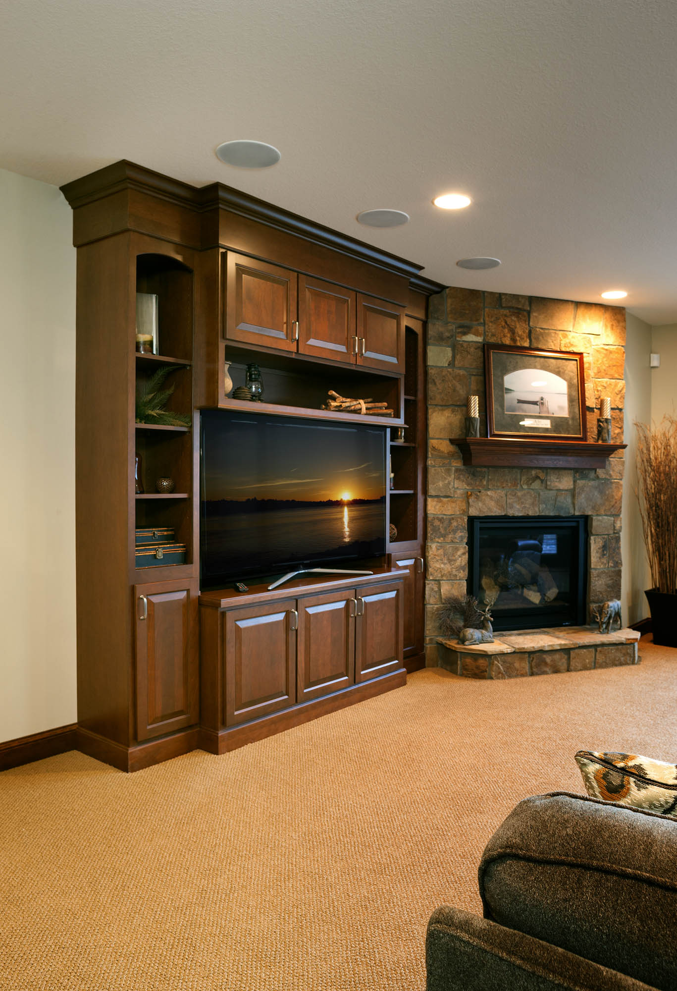 Stained family room entertainment center in Pecan with Ebony Glaze by Showplace Cabinetry - view 1