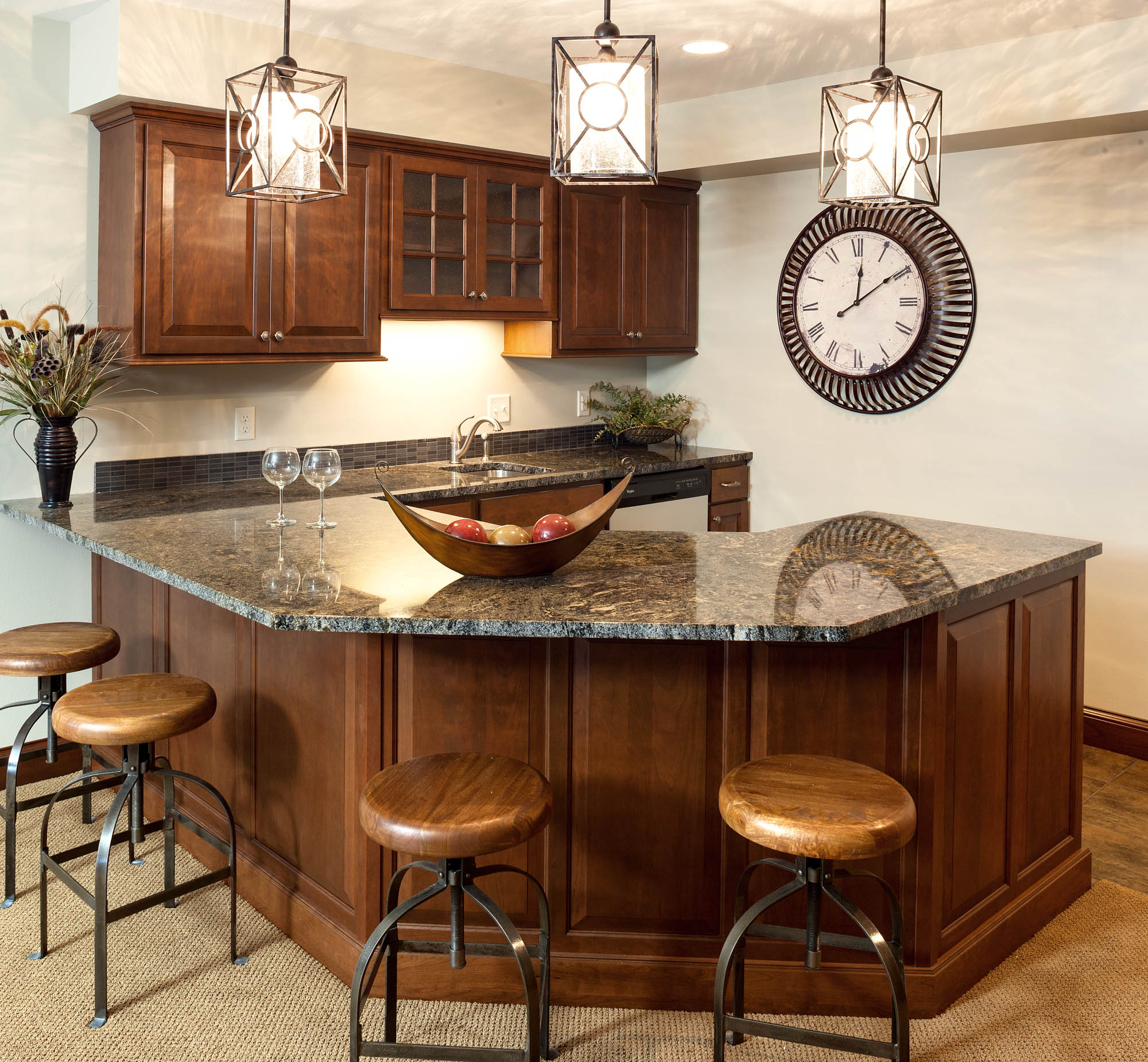Stained family room wet bar in Pecan with Ebony Glaze by Showplace Cabinetry - view 1