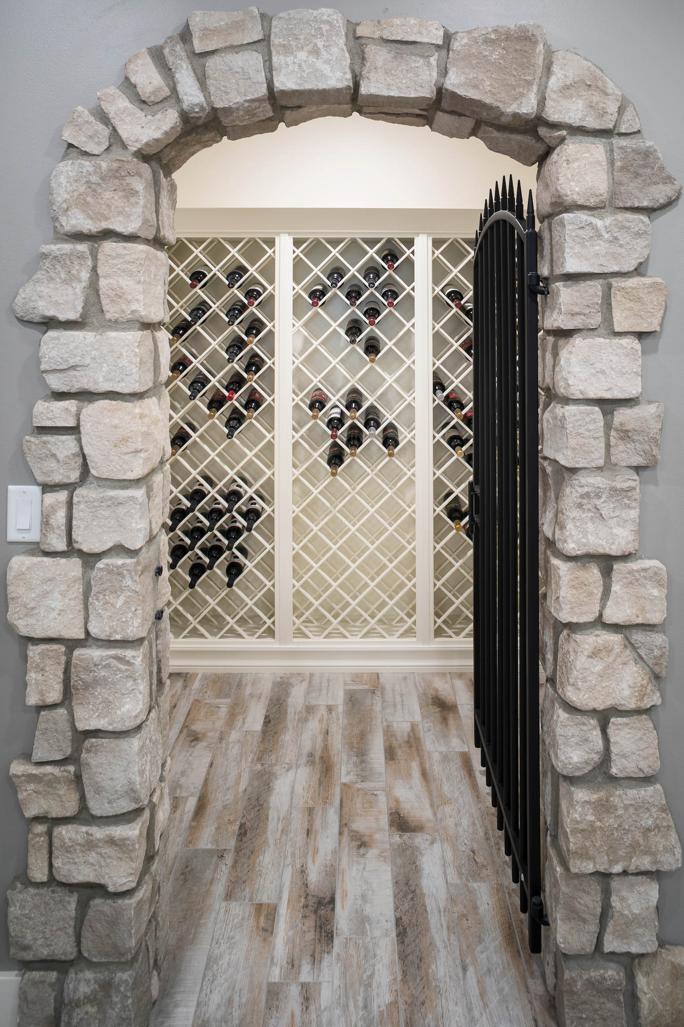 Painted wine cellar wine rack in Soft Cream by Showplace Cabinetry