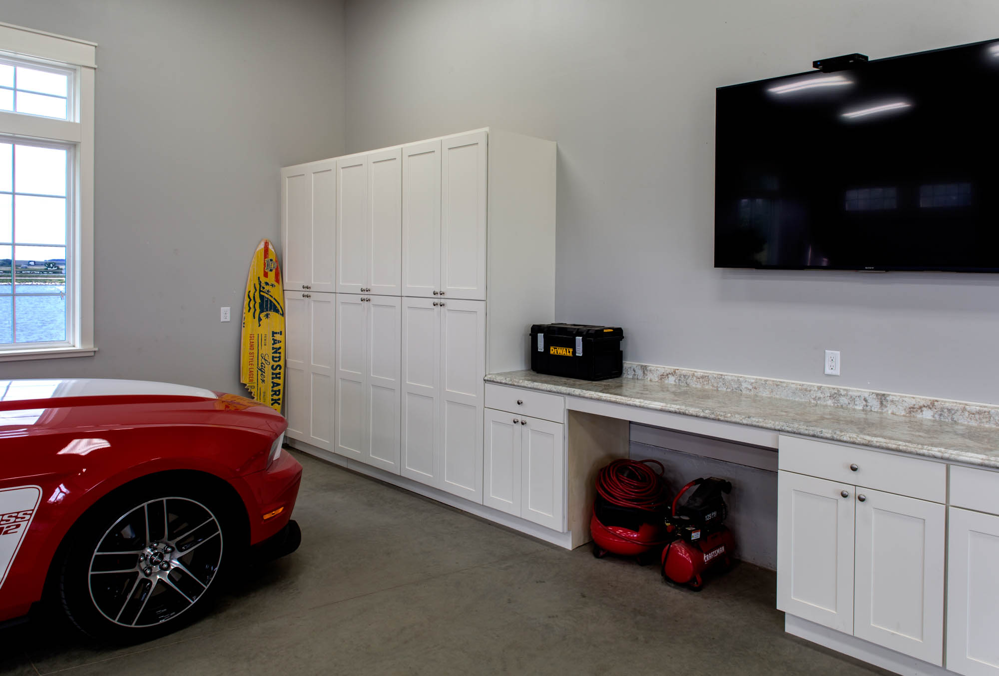 Painted garage cabinets in Soft Cream by Showplace Cabinetry