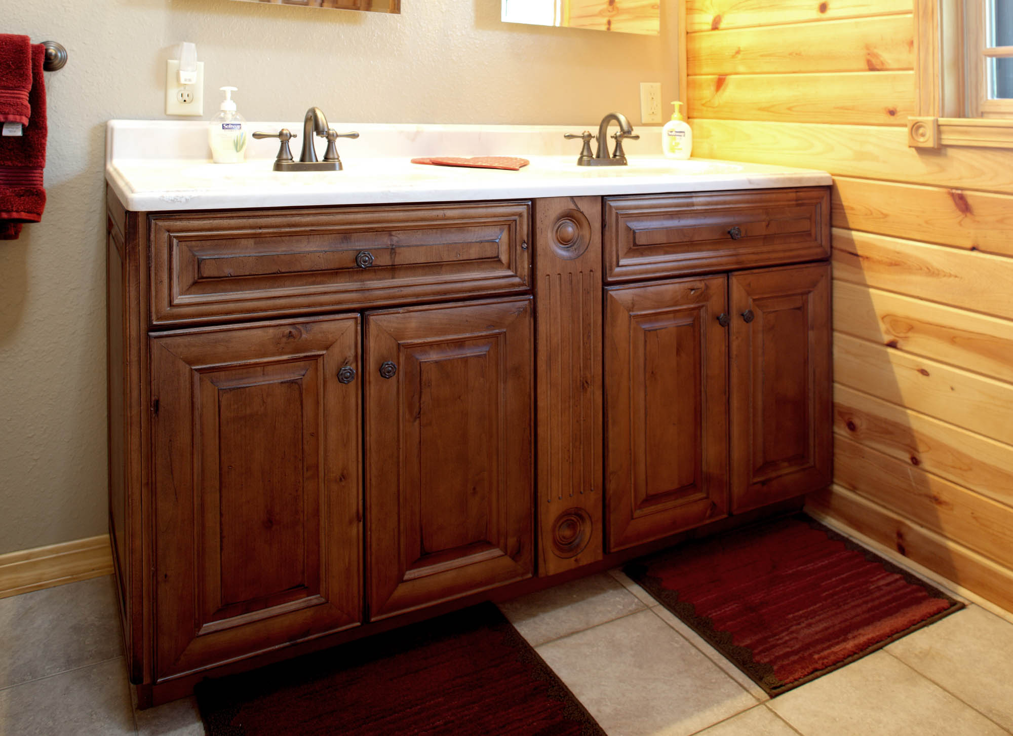 Renew | Stained bathroom vanity in Vintage Autumn by Showplace Cabinetry