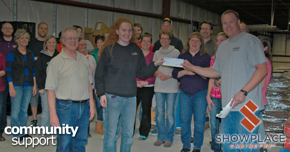 Following an evening of volunteer service to the organization, Showplace employee-owners present a check to Feeding South Dakota.