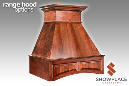 The Chimney Range Hood with Door Panel Valance adds a sweeping arch to its lower border.