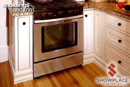 A colonial base molding along the floor adds historic appeal to this painted inset kitchen.