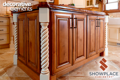 Turned columns in a spiral pattern add a bright accent on the corners of this cherry island.