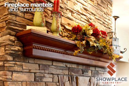 This stone living-room fireplace features a custom Showplace mantel in cherry Vintage Autumn.