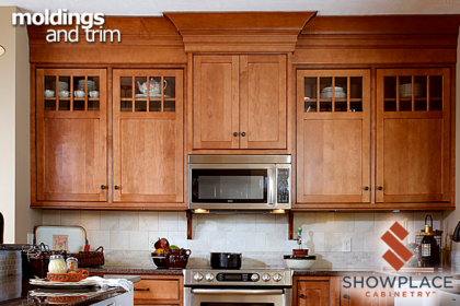 A creative combination of stacked moldings gives this comfortable maple kitchen a strong upper border.